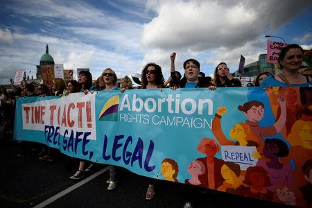 FILE PHOTO: Demonstrators hold posters as they march for more liberal Irish abortion laws in Dublin, Ireland September 30, 2017. REUTERS/Clodagh Kilcoyne/File Photo