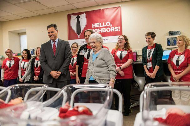 PHOTO: UPMC Magee-Womens Hospital president Richard Beigi, Mrs. Rogers, and Caitlin Pechin, the nurse who made the outfits, visit the newborns. (UPMC Magee-Womens Hospital)