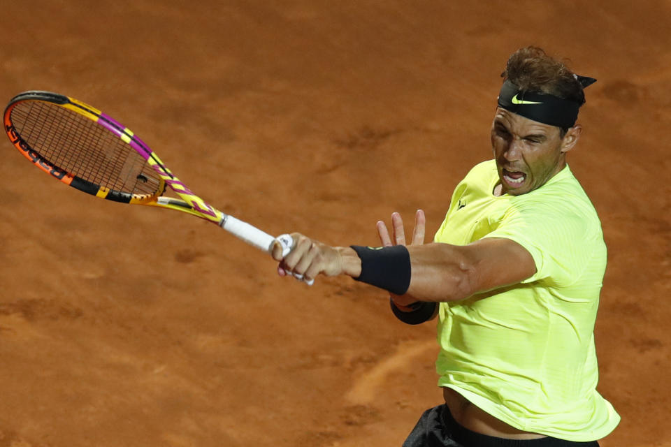 Rafael Nadal hits a forehand to Spain's Pablo Carreno Busta on day three of the Men's Italian Open.