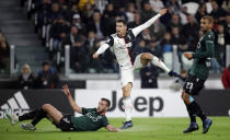 Juventus' Cristiano Ronaldo scores the opening goal during a Serie A soccer match between Juventus and Bologna, at the Allianz stadium in Turin, Italy, Saturday, Oct.19, 2019. (AP Photo/Luca Bruno)