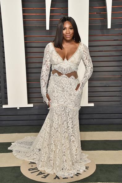 <p>Serena cut a chic figure in this white lace dress at the Vanity Fair Oscar Party. <i>[Photo:Pascal Le Segretain/Getty Images]</i></p>
