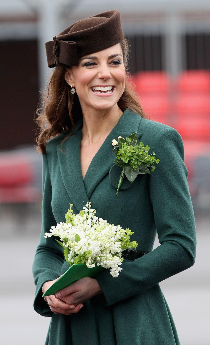 "<p>Settling into her Duchess duties, Kate Middleton visited the Aldershot Barracks in Hounslow for the annual St. Patrick's Day parade in 2012. Middleton presented shamrocks to the Irish Guards, a tradition that <a href=""https://www.townandcountrymag.com/society/tradition/g26838499/kate-middleton-st-patricks-day-shamrocks-irish-guards-photos/"" rel=""nofollow noopener"" target=""_blank"" data-ylk=""slk:dates back to 1901"" class=""link rapid-noclick-resp"">dates back to 1901</a>. <br></p>"