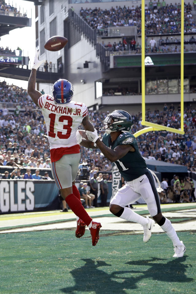 <p>New York Giants' Odell Beckham, left, catches a touchdown against Philadelphia Eagles' Jalen Mills during the second half of an NFL football game, Sunday, Sept. 24, 2017, in Philadelphia. (AP Photo/Matt Rourke) </p>
