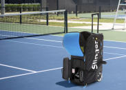 This image provided by Slinger shows a tennis ball launcher bag. Tennis nuts can tote Slinger's portable tennis ball launcher to the court; the bag holds 144 balls, and the five-hour battery means dad can practice his strokes as long as he wants. (Slinger via AP)