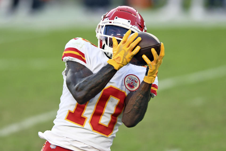 Kansas City Chiefs wide receiver Tyreek Hill (10) pulls in a 44-yard touchdown reception from quarterback Patrick Mahomes during the first half of an NFL football game against the Tampa Bay Buccaneers Sunday, Nov. 29, 2020, in Tampa, Fla. (AP Photo/Jason Behnken)
