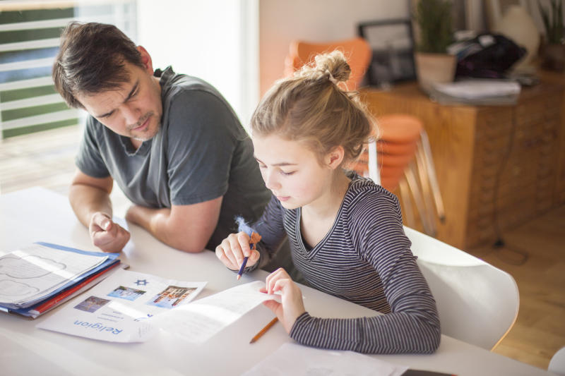 """""""We suggest parents think of themselves as consultants, rather than a kid's manager or boss, or the homework police."""" (Johner Images via Getty Images)"""