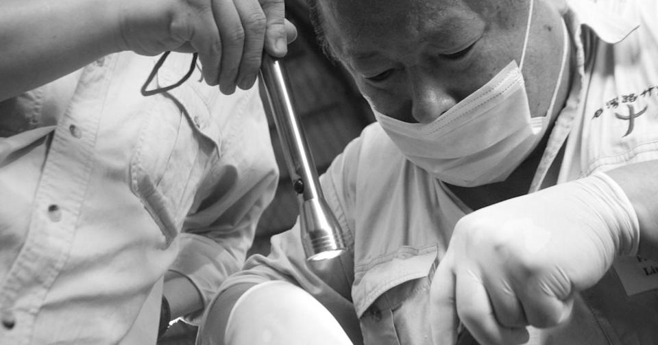 Dr. Liu treats a patient in the Philippines in 2009. (Photo courtesy of TRMPC)