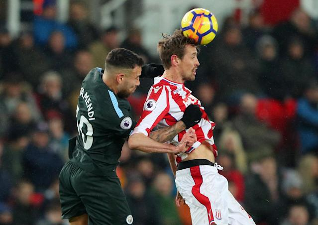 "Soccer Football - Premier League - Stoke City vs Manchester City - bet365 Stadium, Stoke-on-Trent, Britain - March 12, 2018 Manchester City's Nicolas Otamendi in action with Stoke City's Peter Crouch REUTERS/Hannah McKay EDITORIAL USE ONLY. No use with unauthorized audio, video, data, fixture lists, club/league logos or ""live"" services. Online in-match use limited to 75 images, no video emulation. No use in betting, games or single club/league/player publications. Please contact your account representative for further details."