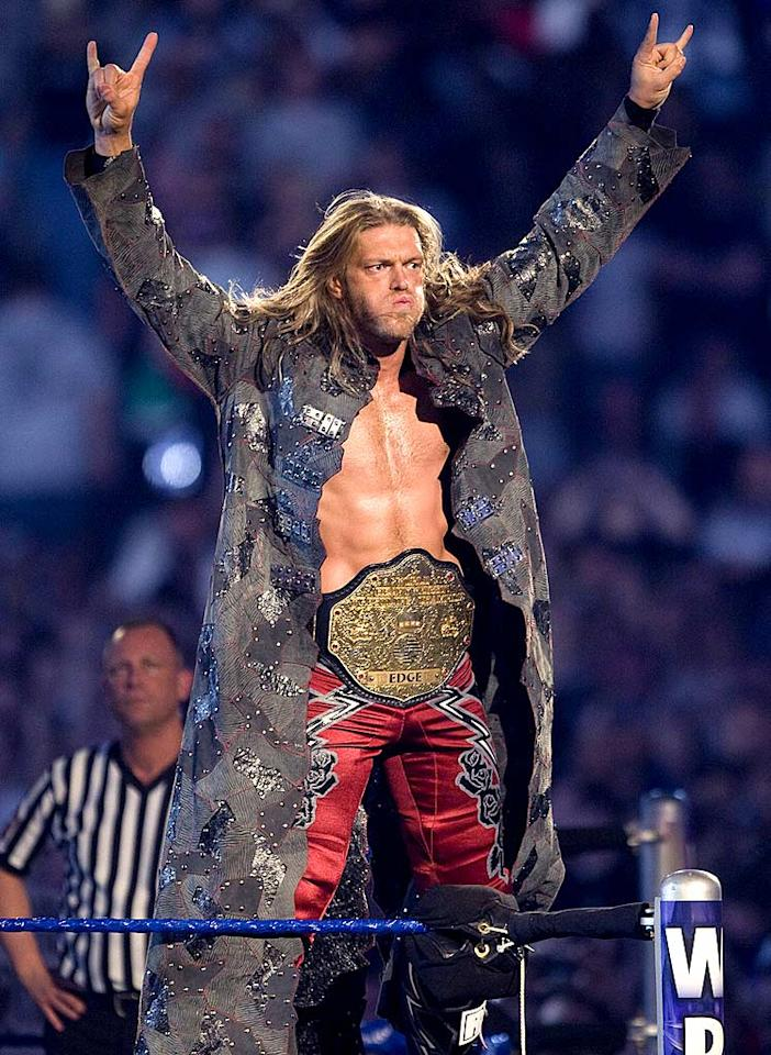 "Edge showed off his belt ... and his abs ... before facing Big Show and John Cena in the penultimate bout, a Triple Threat match. Bob Levey/<a href=""http://www.wireimage.com"" target=""new"">WireImage.com</a> - April 5, 2009"