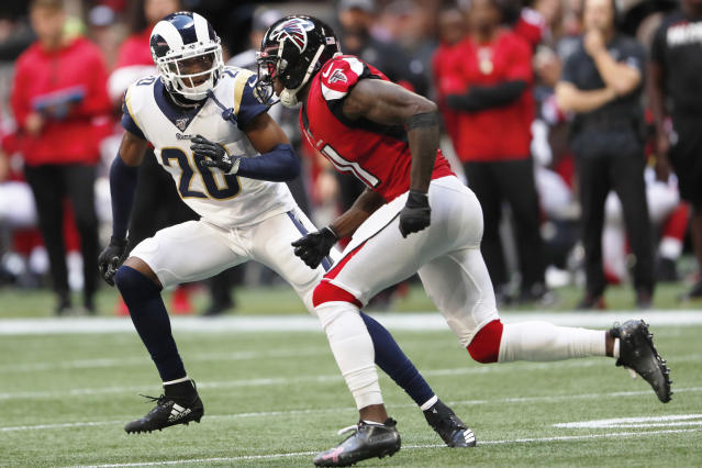 FILE - In this Oct. 20, 2019, file photo, Los Angeles Rams cornerback Jalen Ramsey (20) covers Atlanta Falcons wide receiver Julio Jones (11) during the first half of an NFL football game in Atlanta. Ramsey makes his home debut for the Rams this weekend, over a month after they acquired the star cornerback in a trade with Jacksonville. Ramseys arrival has been one of the smoothest aspects of the past few weeks for the Rams, who are in danger of falling out of the playoff race due to a sputtering offense. (AP Photo/John Bazemore, File)