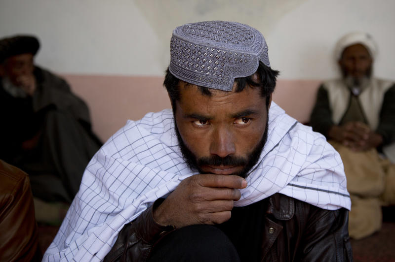 Afghan man Naimatullah looks on as he speaks about how he was picked up several months ago by U.S. Special Forces along with his brothers, fingerprinted and the isometrics on his eyes done before being released in Maidan Shahr, Wardak province, Afghanistan, Sunday, March 10, 2013. Both his brothers are still in custody though he has been unable to find out where they are being held.Afghan President Hamid Karzai, infuriated by villager reports of forced detentions and mass arrests, gave U.S. Special Forces two weeks to vacate Wardak province, located barely 30 kilometers (24 miles) from the Afghan capital of Kabul. The deadline for their withdrawal expired midnight Sunday, March 10, 2013. (AP Photo/Anja Niedringhaus)