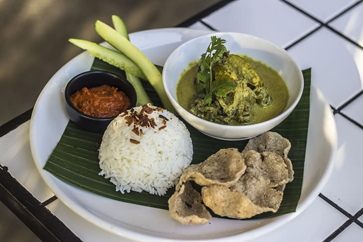 An unusual dish is the 'itik salai lemak cili' with 'belimbing buluh' served with rice