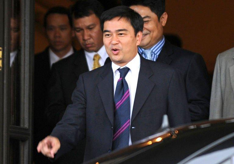 Thai Prime Minister Abhisit Vejjajiva leaves Government House in Bangkok. Thailand's election countdown began on Monday when the government set July 3 for what promises to be a tough battle, after the king endorsed a decree to dissolve the lower house of parliament