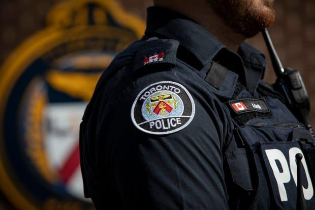 Whitby man Ryan Walters has been charged with performing an indecent act in a public place and dangerous operation of a conveyance. The Toronto police officer is currently suspended with pay. (Evan Mitsui/CBC - image credit)