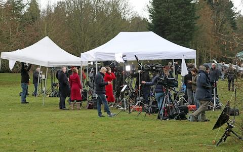 <span>Members of the media gather outside the visitors' centre at the Sandringham Estate, Norfolk, where Queen Elizabeth II and senior royals held crisis talks over Duke and Duchess of Sussex future roles</span> <span>Credit: PA </span>