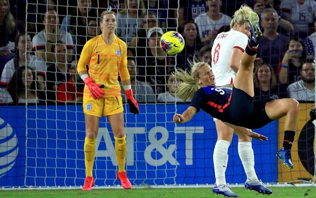Lindsey Horan attempted an acrobatic shot as the USA dominated England - Mike Ehrmann/GETTY IMAGES