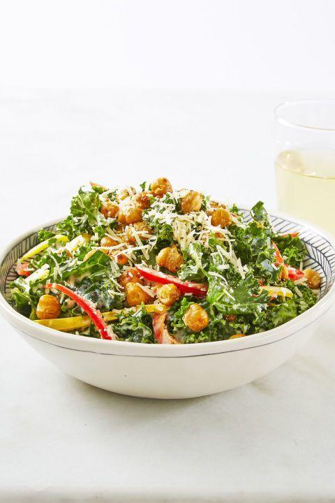 """<p>Crispy, crunchy and oh-so-satisfying, this kale caesar salad is a healthy, hearty dinner for any night of the week. </p><p><em><a href=""""https://www.goodhousekeeping.com/food-recipes/a38876/crunchy-chickpea-kale-caesar-recipe/"""" rel=""""nofollow noopener"""" target=""""_blank"""" data-ylk=""""slk:Get the recipe for Crunchy Chickpea Kale Caesar »"""" class=""""link rapid-noclick-resp"""">Get the recipe for Crunchy Chickpea Kale Caesar »</a></em></p>"""