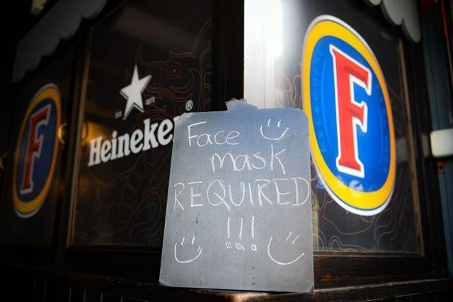 Facemasks will remain mandatory in Wales on public transport and many indoor venues (Ben Birchall/PA).