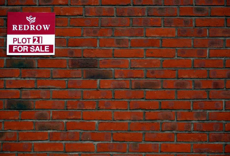 FILE PHOTO: Signage is seen on a house on a Redrow housing development in Church Greasly