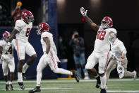 Alabama defensive lineman Phidarian Mathis (48) and other players celebrate victory after the Southeastern Conference championship NCAA college football game against Florida, Sunday, Dec. 20, 2020, in Atlanta. Alabama won 52-46. (AP Photo/Brynn Anderson)