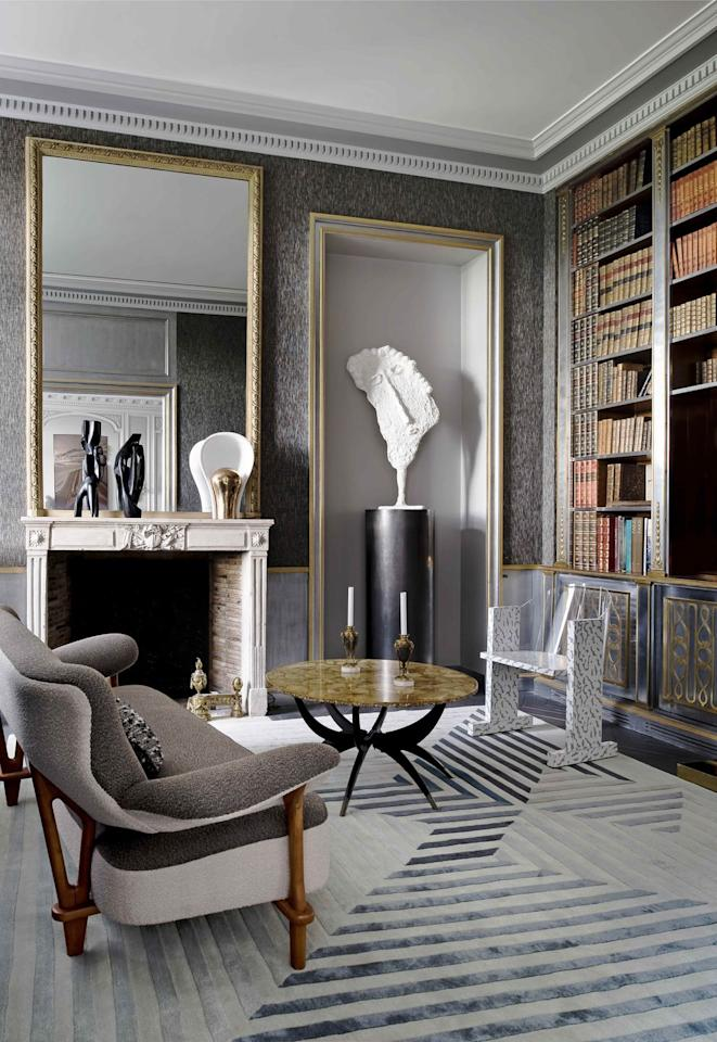 "<p>In this <a href=""https://www.veranda.com/home-decorators/a30145127/jean-louis-deniot-paris-flat/"" target=""_blank"">18th-century Paris library</a>, a vintage Maison Jansen bookcase inspired the room's smokey palette and array of textures. Designer  <a href=""https://www.deniot.com"" target=""_blank"">Jean-Louis Deniot</a> moved the shelving from the dining room into its new home before adding tweed wall upholstery. The graphic rug from Galerie Diurne and gold-trimmed alcove offer a gallery-like feel to the space. The figurative sculpture is by Philippe Valentin. </p>"