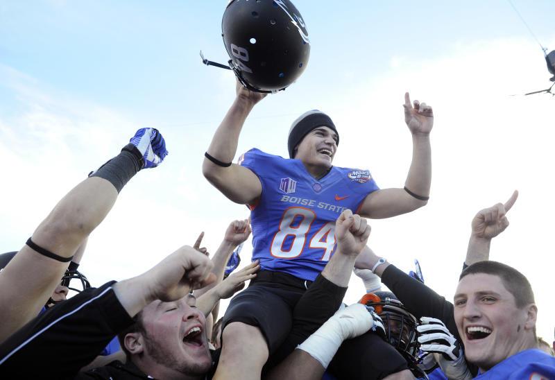 Boise State kicker Michael Frisina (84) celebrates after his team defeated Washington at the MAACO Bowl NCAA college football game on Saturday, Dec. 22, 2012, in Las Vegas. Frisina kicked the go-ahead field goal in the fourth quarter for a 28-26 final. (AP Photo/David Becker)