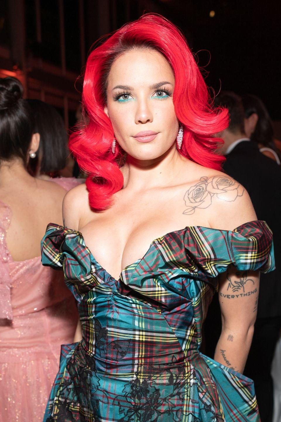 """<p>Halsey has been pretty open about her bisexuality since before she became a breakout star on the music scene. She continues to fight for bisexual representation in music and even released several songs about being bisexual in her albums, <a href=""""https://www.youtube.com/watch?v=RVd_71ZdRd4"""" rel=""""nofollow noopener"""" target=""""_blank"""" data-ylk=""""slk:including a duet with Lauren Jauregui called &quot;Strangers.&quot;"""" class=""""link rapid-noclick-resp"""">including a duet with Lauren Jauregui called """"Strangers."""" </a></p>"""
