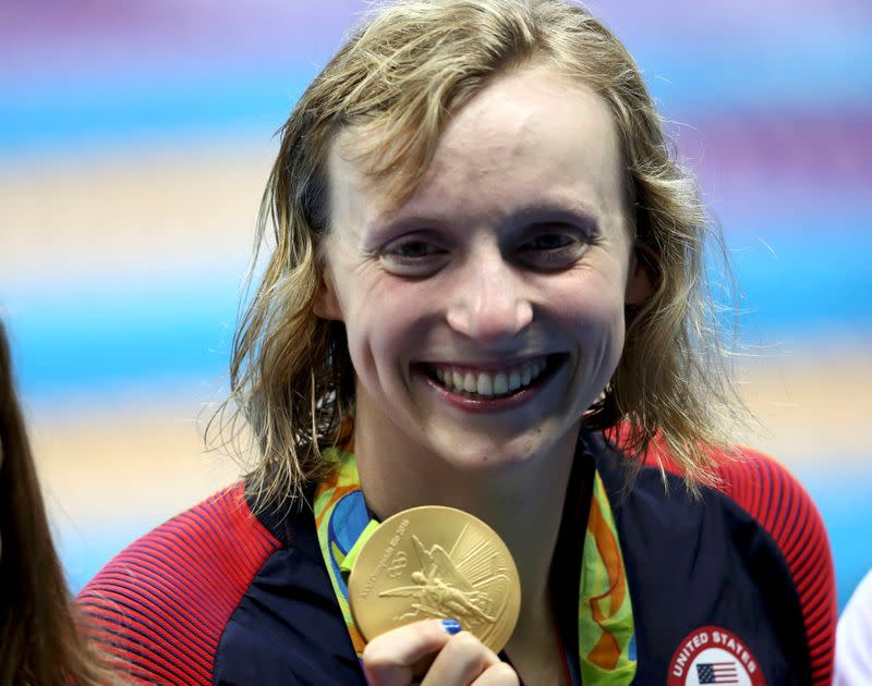 FILE PHOTO: Katie Ledecky (USA) poses with her Olympic 800m freestyle gold medal