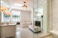 There are 8 bathrooms, with marble for days.