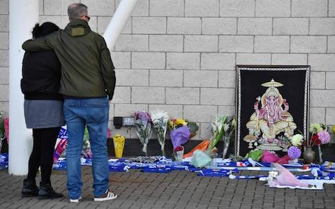 <span>Fans pause in front of floral tributes outside King Power Stadium on Sunday morning</span> <span>Credit: Getty Images </span>
