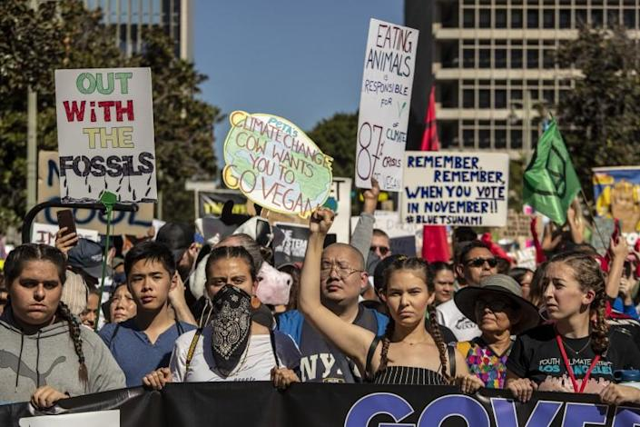 "Activists with Youth Climate Strike Los Angeles take to the streets Nov. 1 for a march. <span class=""copyright"">(Los Angeles Times)</span>"