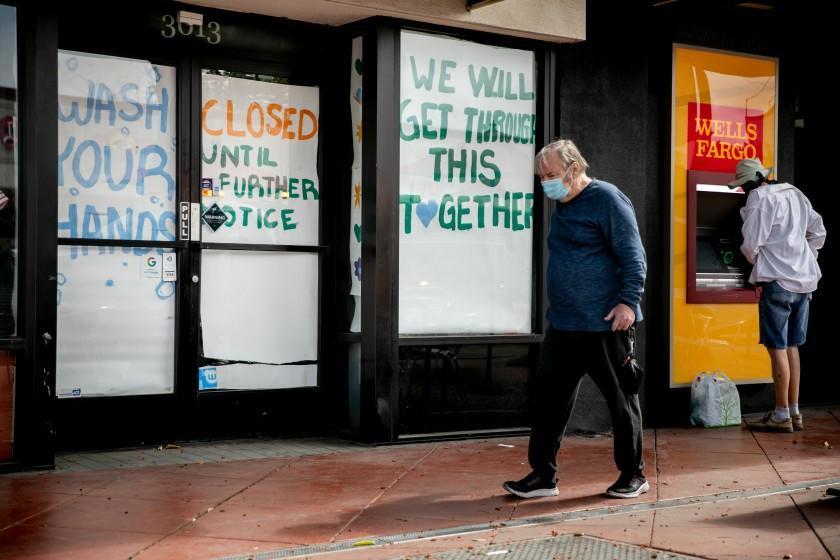 A boutique is shut down on University Avenue, immediately next to a Wells Fargo ATM on May 28, 2020 in San Diego, California.