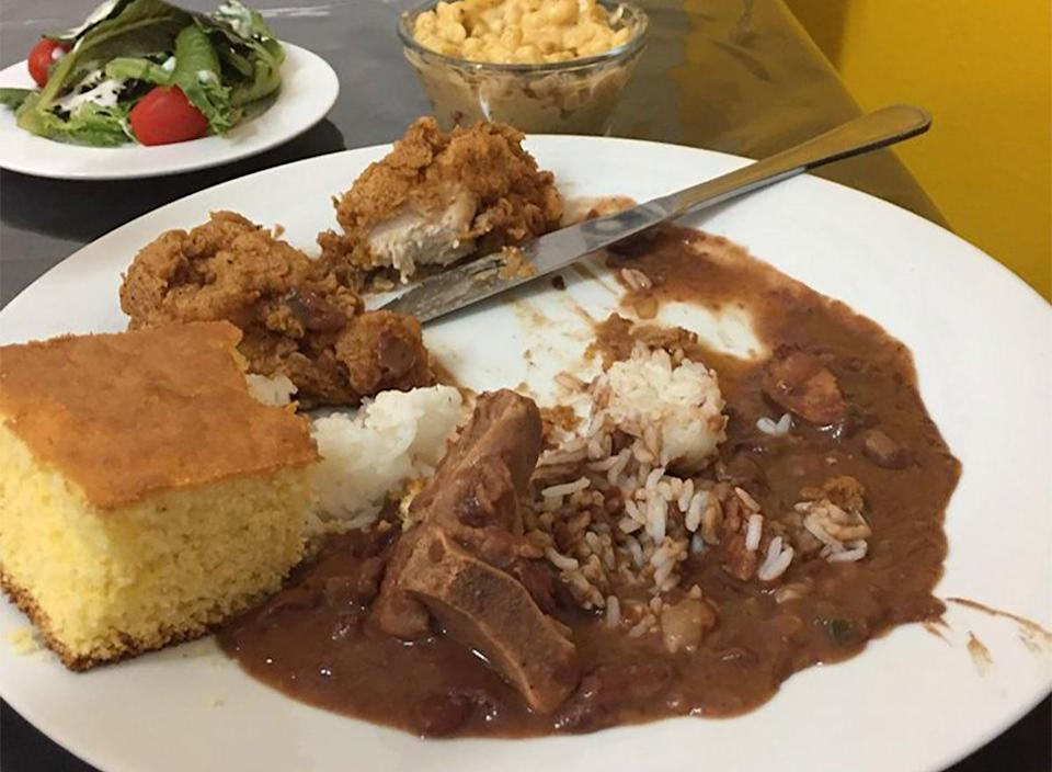 plate of fried chicken with rice and beans and cornbread