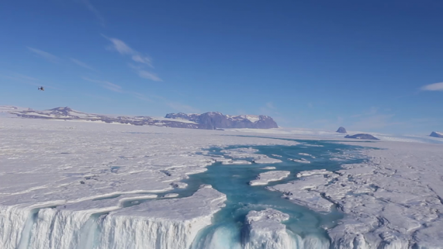 a-130-metre-wide-antarctic-waterfall-plunges-over-the-nansen-ice-shelf