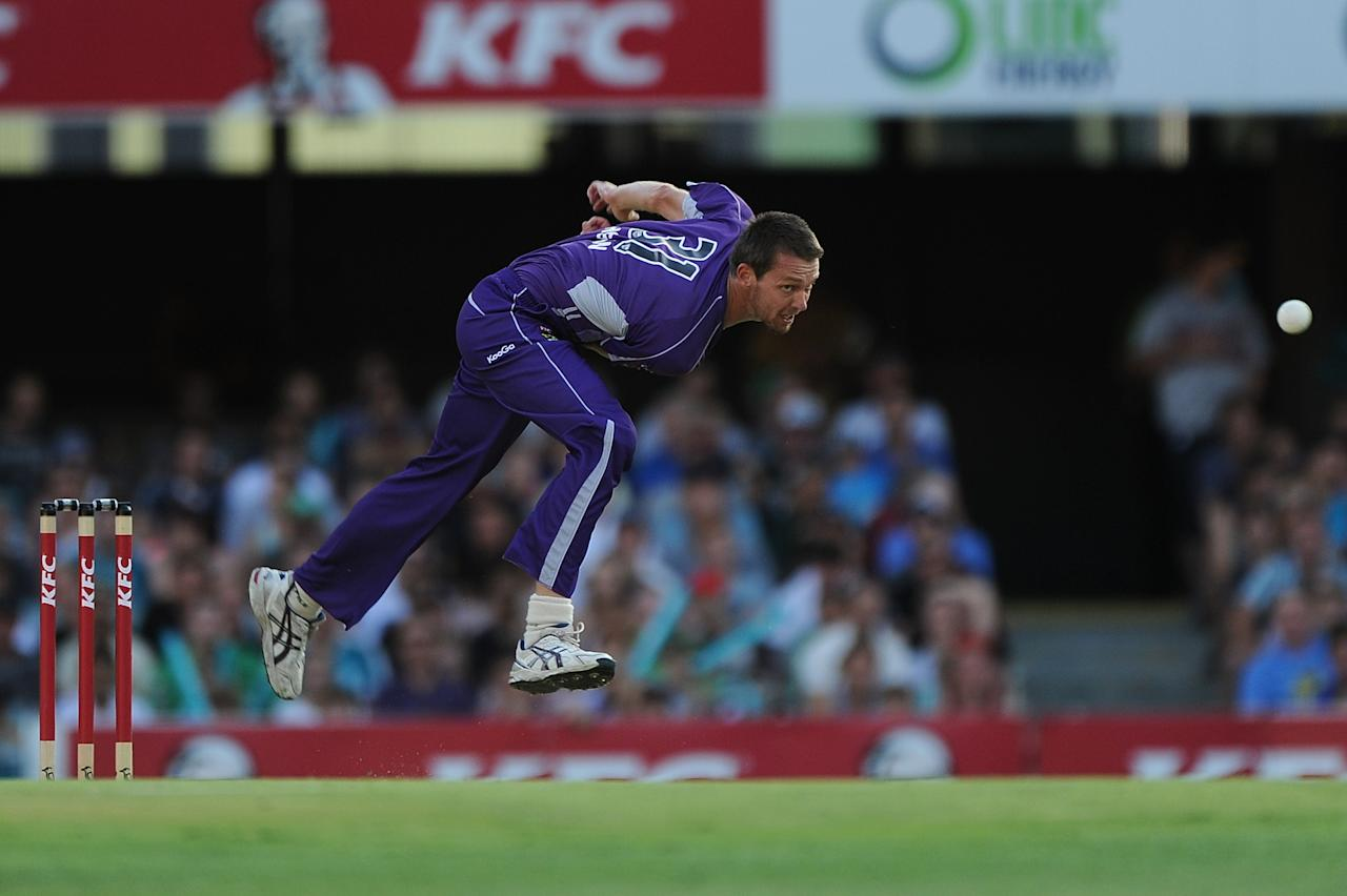 BRISBANE, AUSTRALIA - DECEMBER 09:  Michael Hogan of the Hurricanes bowls during the Big Bash League match between the Brisbane Heat and the Hobart Hurricanes at The Gabba on December 9, 2012 in Brisbane, Australia.  (Photo by Matt Roberts/Getty Images)
