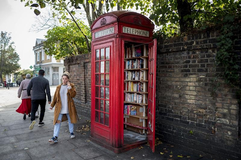 On Lewisham Way in south London, a phone box has been turned into a book exchange (AFP Photo/TOLGA AKMEN)