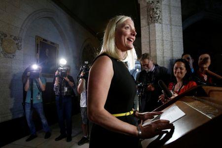 Canada's Environment Minister Catherine McKenna speaks to journalists on Parliament Hill in Ottawa