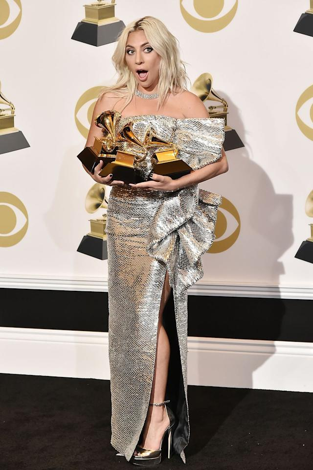 """<p>Let's take another look at Gaga's Grammys dress, this time with three shiny new Grammys. One of those is for Best Pop Duo/Group Performance for """"Shallow,"""" which means, yes, <a rel=""""nofollow"""" href=""""https://www.cosmopolitan.com/entertainment/a26090231/bradley-cooper-more-grammys-artists-count-2019-shallow-a-star-is-born-lady-gaga/"""">Bradley Cooper is now a Grammy winner</a>. Seriously, have you seen anything more beautiful?</p>"""
