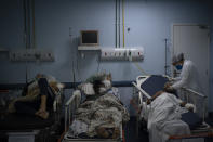Patients waiting for test results are treated in a temporary room before being moved to a COVID-19 area of the municipal hospital in Sao Joao de Meriti, Rio de Janeiro state, Brazil, Thursday, April 8, 2021. (AP Photo/Felipe Dana)