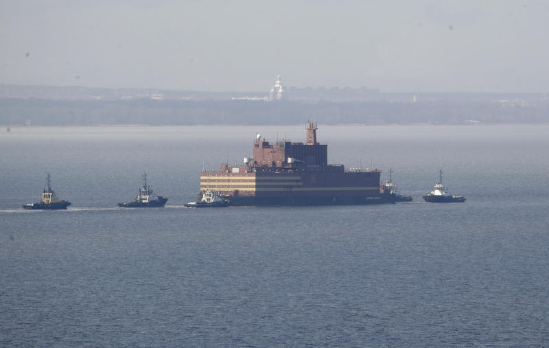 FILE - In this Saturday, April 28, 2018 file photo, the floating nuclear power plant, the 'Akademik Lomonosov', is towed out of the St. Petersburg shipyard where it was constructed in St. Petersburg, Russia. The Akademik Lomonosov that carries two 35-megawatt nuclear reactors set out Friday Aug. 23, 2019, from the Arctic port of Murmansk on the Kola Peninsula on a three-week journey to Pevek on the Chukotka Peninsula. (AP Photo/Dmitri Lovetsky, File)