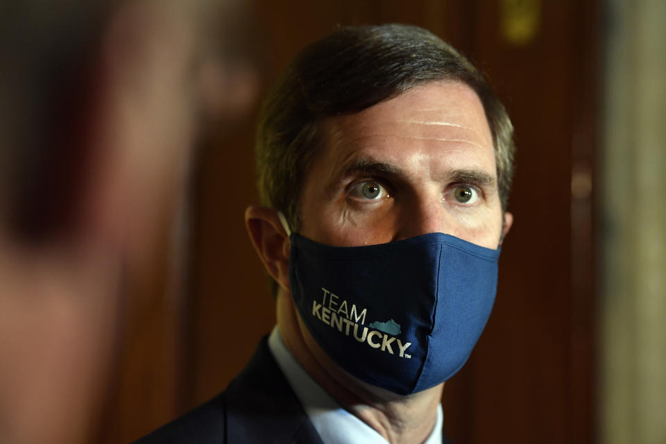 Kentucky Governor Andy Beshear listens to a reporters question following the signing of bills related to the American Rescue Plan Act at the Kentucky State Capitol in Frankfort, Ky., Wednesday, April 7, 2021. (AP Photo/Timothy D. Easley)