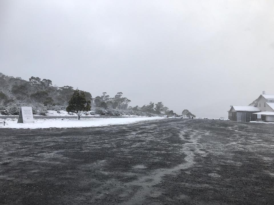 Snow is seen outside Great Lake General Store in Miena, Tasmania.