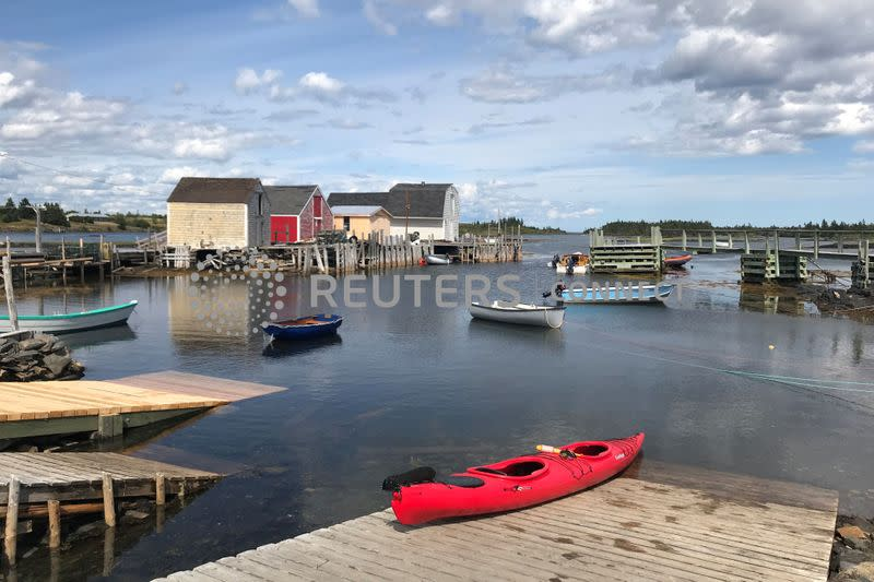 A red kayak is pictured on a dock in Blue Rocks