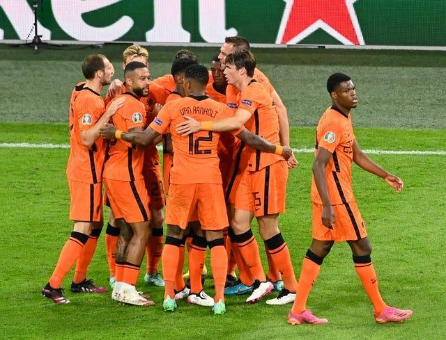 Holland's players celebrate after scoring a second goal against Ukraine