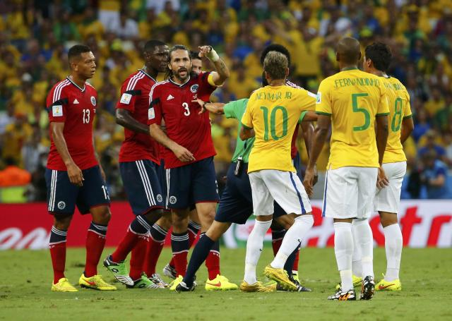Brazil and Colombia players argue during their 2014 World Cup quarter-finals at the Castelao arena in Fortaleza July 4, 2014. REUTERS/Yves Herman (BRAZIL - Tags: SOCCER SPORT WORLD CUP)