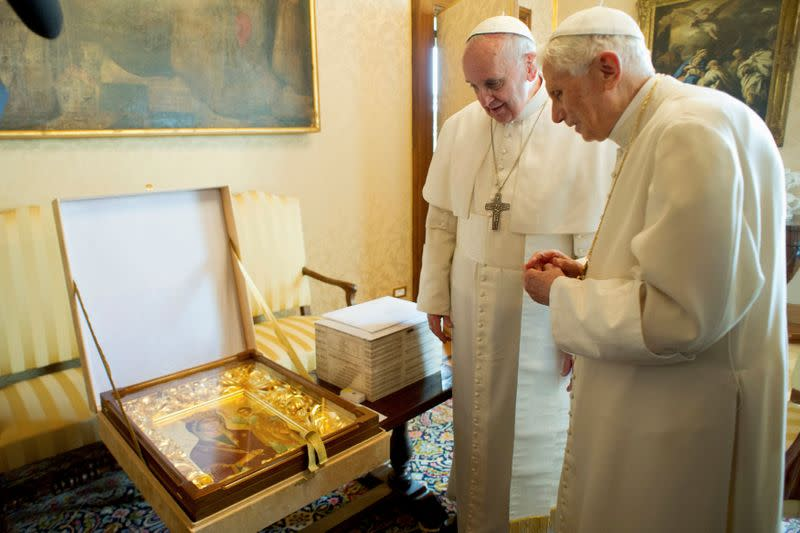 FILE PHOTO: Pope Francis exchanges gift with Pope Emeritus Benedict XVI at the Castel Gandolfo summer residence