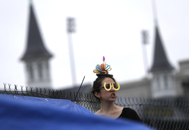 <p>Emily Falco of Denver watches a race before the 144th running of the Kentucky Derby horse race at Churchill Downs Saturday, May 5, 2018, in Louisville, Ky. (Photo: John Minchillo/AP) </p>