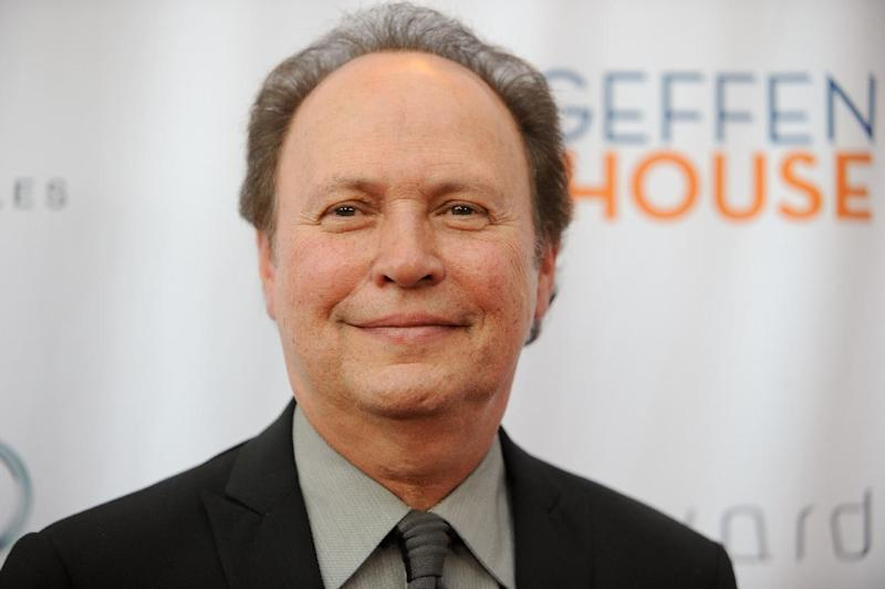 """FILE - This May 13, 2013 file photo shows actor Billy Crystal at the annual """"Backstage At The Geffen"""" event at the Geffen Playhouse in Los Angeles. The star of """"City Slickers"""" and """"When Harry Met Sally"""" said Tuesday, May 14,  he will reprise his funny and poignant one-man autobiographical show """"700 Sundays"""" on Broadway for a 9-week stand this fall. (Photo by Richard Shotwell/Invision/AP, file)"""