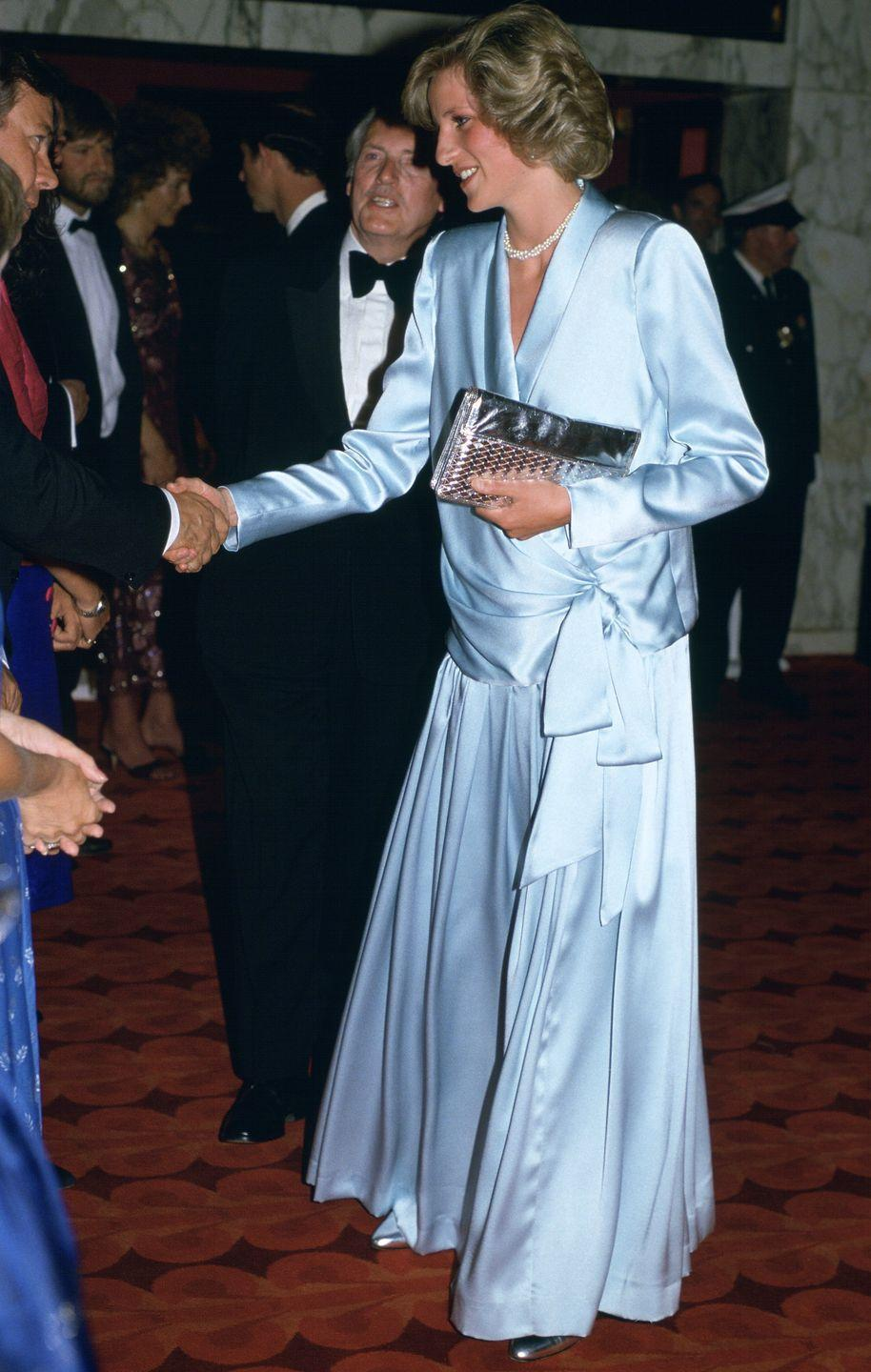 <p>While expecting Prince Harry, Princess Diana wore a pale blue silk draped tuxedo gown to the London premiere of <em>Indiana Jones and the Temple of Doom. </em>The royal's maternity look was created by Catherine Walker. </p>