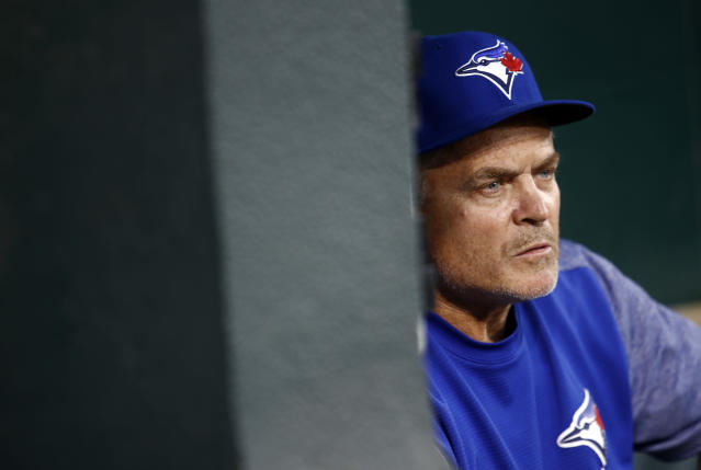 Toronto Blue Jays manager John Gibbons sits in the dugout before a baseball game against the Baltimore Orioles, Tuesday, Sept. 18, 2018, in Baltimore. (AP Photo/Patrick Semansky)